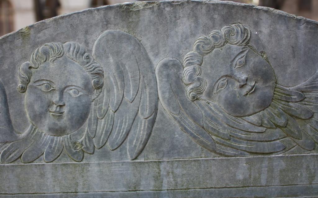 Cherubs grave marker detail
