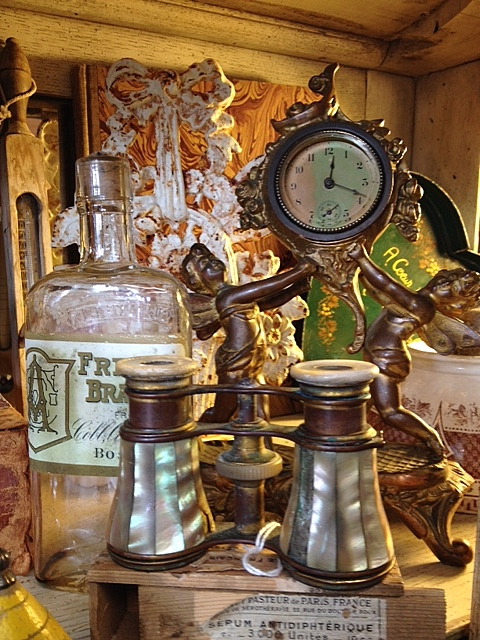 Clock, opera glasses, bottle