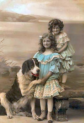 Portrait two girls with dog