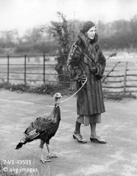 Woman walking a turkey